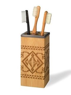 BAMBOO BASKET TOOTHBRUSH HOLDER  Part of the same collection as the Bamboo Basket Lotion Pump, the Native American-inspired geometrics on this toothbrush holder are also laser-engraved on eco-friendly bamboo. We think it would also look great on a desk and filled with pens and pencils.