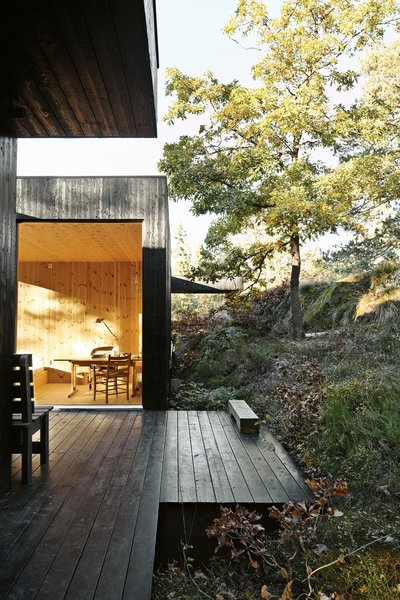 "The house is divided into three sections connected by a series of outdoor galleries. ""When I walk from one room to another, I have to go outdoors and feel the weather and nature—rain, cold, and sun,"" says Sævik.   Instead of emphasizing the expansive panorama of oak, pine, and aspen trees, the house frames select views—a move inspired by Japanese design."