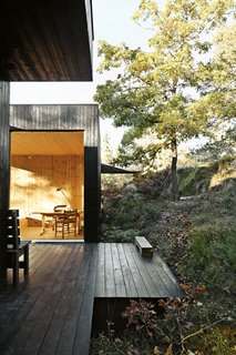 """The house is divided into three sections connected by a series of outdoor galleries. """"When I walk from one room to another, I have to go outdoors and feel the weather and nature—rain, cold, and sun,"""" says Sævik.   Instead of emphasizing the expansive panorama of oak, pine, and aspen trees, the house frames select views—a move inspired by Japanese design."""