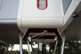 An electric car–charging station is situated underneath the house.