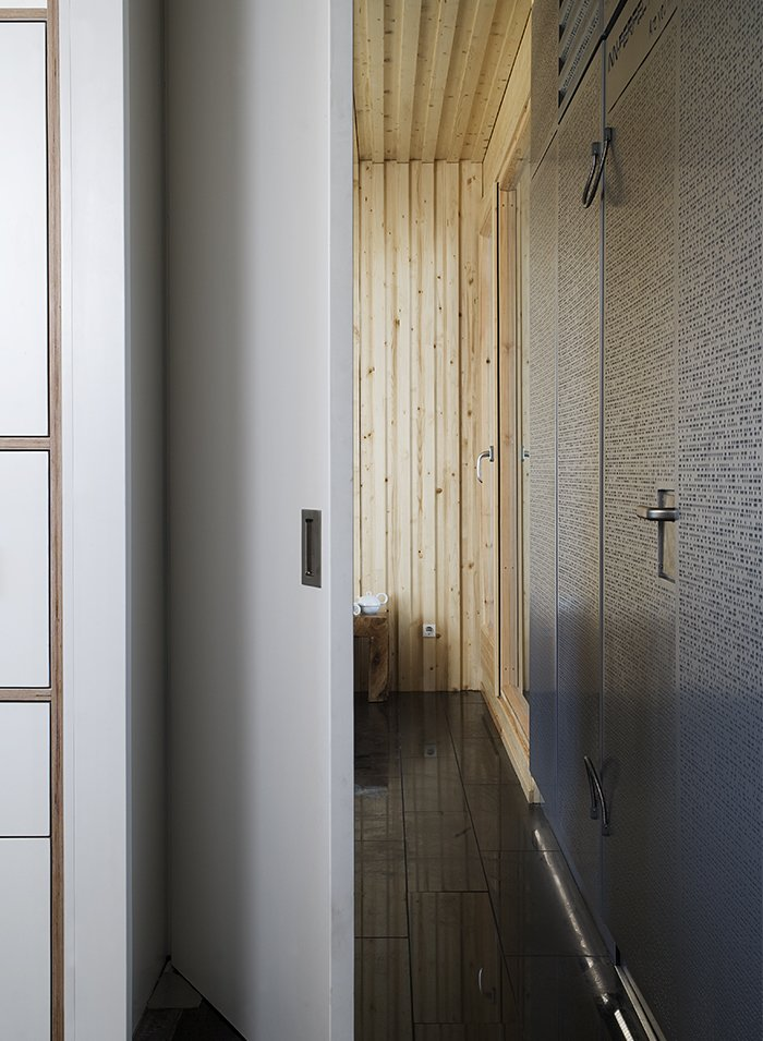 Hallway Spruce clads the interior walls and ceilings.  Photo 4 of 9 in This Futuristic Prefab in Spain Has All the High-Tech Gizmos of a Spaceship