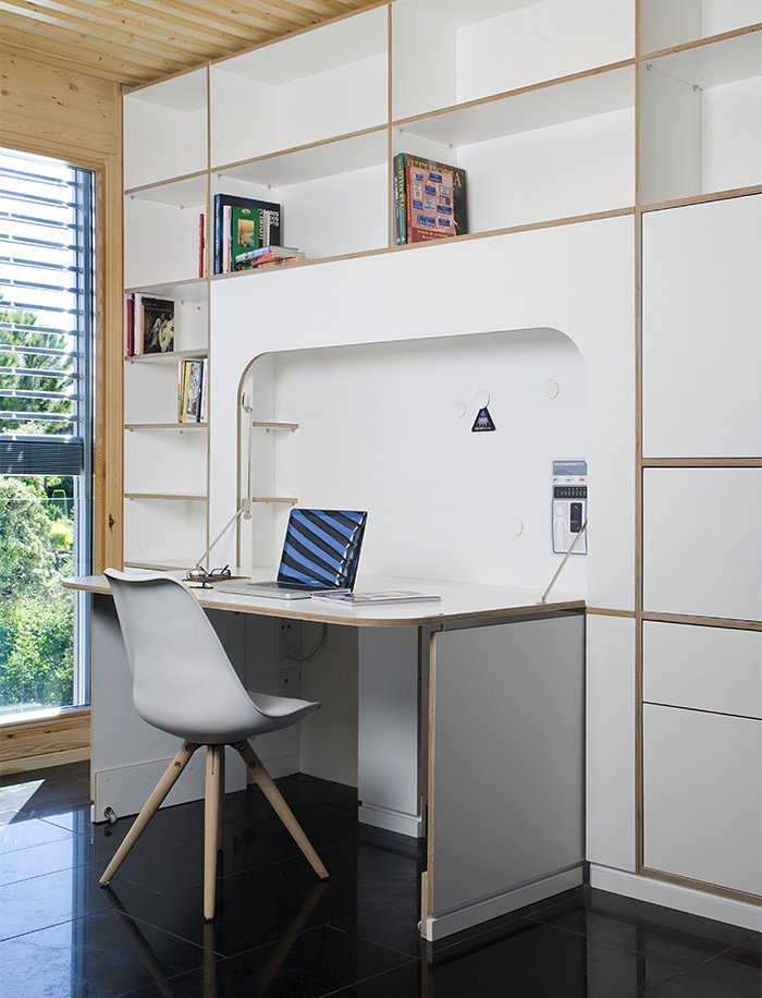 Office, Bookcase, Chair, Desk, Study Room Type, Library Room Type, and Shelves A built-in desk by NOEM FabLab folds into the wall when not in use.  Photo 8 of 9 in This Futuristic Prefab in Spain Has All the High-Tech Gizmos of a Spaceship