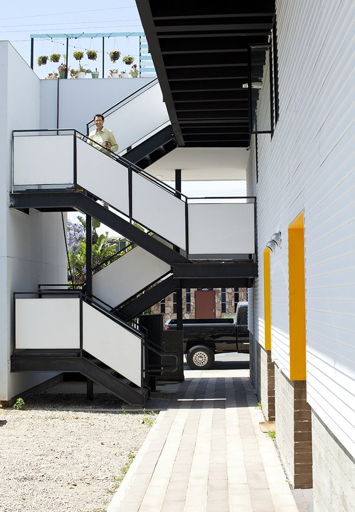 "Staircase and Metal Railing ""The simple volume of the space and large openings let light and air flow freely,"" Benson says. ""The environment is always pleasant even without air conditioning or heating.""  Photo 13 of 14 in San Diego Teaches Us How Micro-Living Can Thrive"