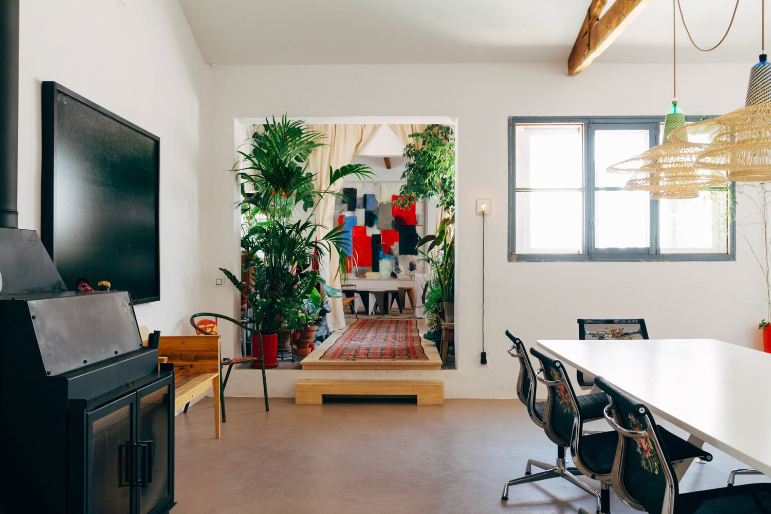 """""""The three things that come with me everywhere are my books, my music and my plants,"""" Catalán de Ocón says.  Search """"madrid couple remake apartment one their childhood buildings"""" from Tour the Cozy and Quirky Madrid Apartment of Product Designer Alvaro Catalan de Ocon"""