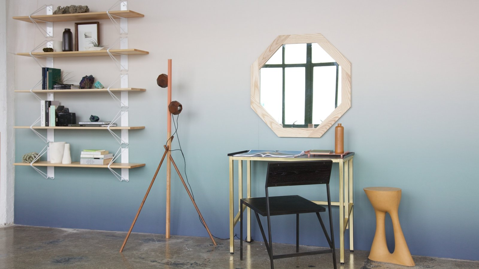 Among WorkOf's collection are, from left to right, shelving by Souda Collective, floor lamp by Bower, desk by Saw, chair by Farrah Sit, trays by Saw, mirror by David Gaynor, and side table by Souda. The wallpaper is by Calico Wallpaper. Photo by Emily Johnston.  Photo 1 of 6 in WorkOf: Building a Community of Brooklyn Makers