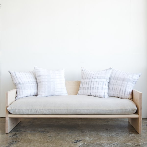 "Maple and brass sofa by Farrah Sit and Rebecca Atwood  This sofa—exclusive to WorkOf—was born out of a collaboration between furniture designer Farrah Sit and textile designer Rebecca Atwood. The frame is Sit's; the upholstery Atwood's. ""A lot of overlaps exist in their tastes and their styles,"" Neamonitis says. Photo by Emily Johnston."