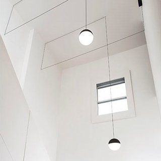The Anastassiades String Pendant Lights from Flos bring suspension lighting to the ceiling. Available with spherical and conical pendants, each Anastassiades String Light provides diffused light, and can be used as overhead lighting in living rooms, bedrooms, or dining rooms. With two different cable lengths, the pendants can be strung in a variety of configurations from simple and streamlined to geometric and intricate. Each pendant light includes a weighted floor switch or ceiling canopy and several hooks with which to string the pendant. Each String Pendant Light can be used individually or grouped with other lights in the series to create a robust lighting display.
