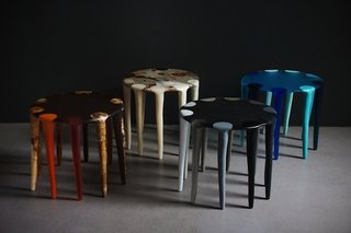 """In a nod to their symbiosis with art, the couple likens their work with table creation to that of the painter's palette. """"Resin is like working with paint, each color is mixed and poured by hand then hand sanded. The side tables are like functional works of art,"""" says Olsen."""