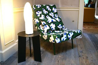 """Danish brand HAY delved into Memphis designer Nathalie Du Pasquier's archive to reissue a series of printed cotton textiles as part of its """"Wrong for HAY"""" collection. Shown here is Sebastian Wrong's """"Curve"""" chair upholstered in a blue, green, white, and black pattern called """"Ice""""."""