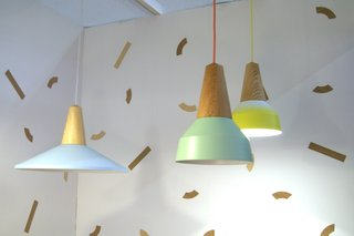 Stylish Stacks  Colorful components were stacked together into modern totems to create one-of-a kind lighting, furniture and accessories.  German designers Schneid presented the Eikon lamps, turned-ash pendants with interchangeable metal shades that are simply attached with magnets.