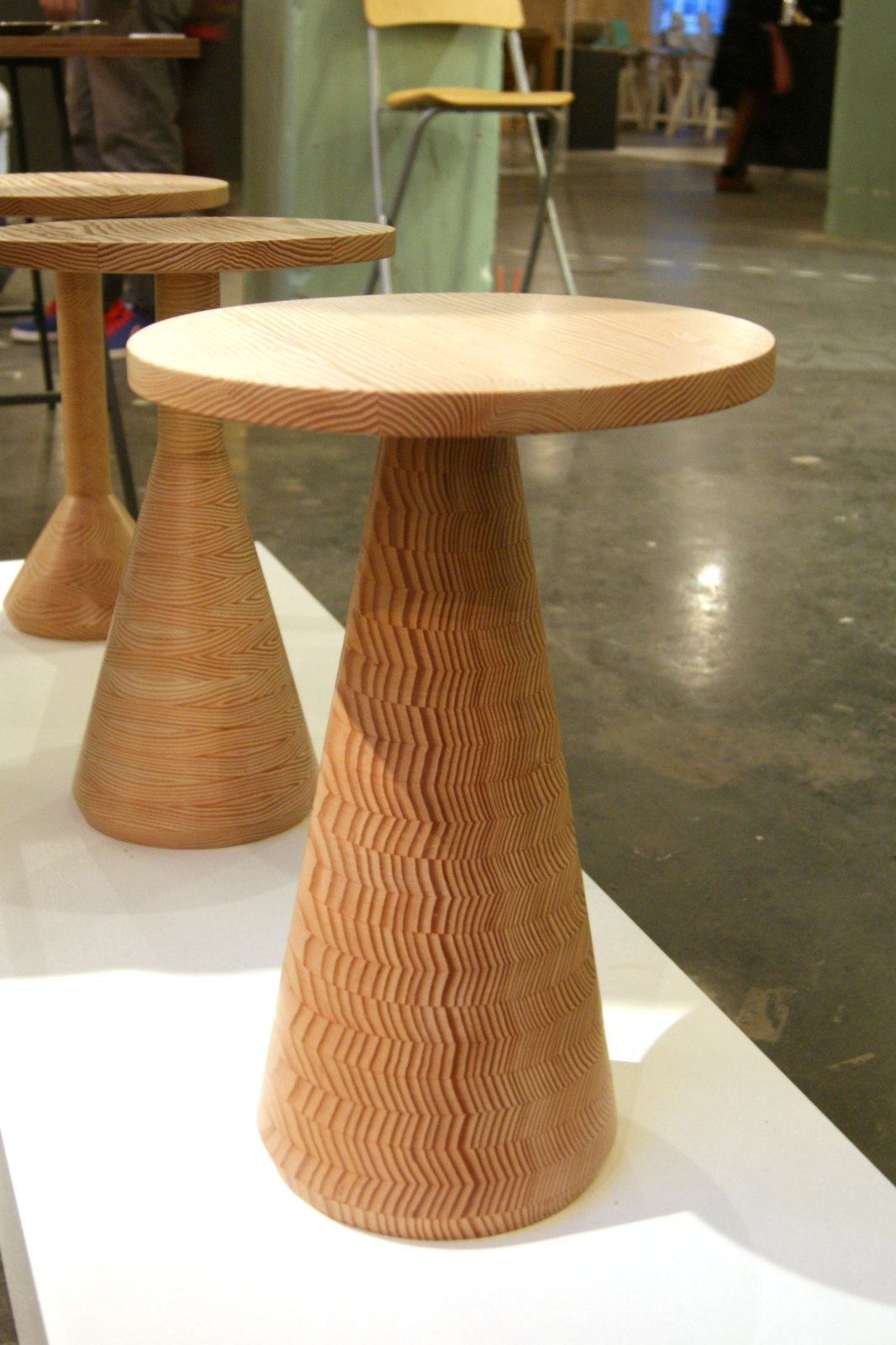 Decorative Wood  Intricate inlays, colorful resins and cleverly cut timbers were spotted on the stands of both established and emerging designers.  The Douglas Fir used to make Gavin Coyle's Jac tables is sawn and stacked together in a carefully constructed sequence that transforms the timber's annual growth rings into a decorative feature.  Key Trends from 2013 London Design Festival by Ali Morris