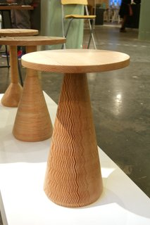 Decorative Wood  Intricate inlays, colorful resins and cleverly cut timbers were spotted on the stands of both established and emerging designers.  The Douglas Fir used to make Gavin Coyle's Jac tables is sawn and stacked together in a carefully constructed sequence that transforms the timber's annual growth rings into a decorative feature.