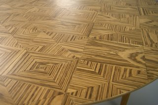 London-based designers Lightning and Kinglyface presented a collection of three tables made from a variety of exotic hardwoods, including Zebrawood from West Africa and Tiger Fig from Brazil. Called Zebra, Tiger, and Larch, the table's tops each feature an intricate geometric inlay pattern.