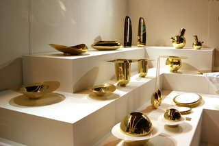 Over at 100% Design, architect Alex Meitlis launched a new sculptural collection of polished brass accessories for silversmiths, Hazorfim.