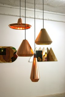 At the TENT London exhibition in east London, Dutch Designer David Derksen exhibited a collection of multi-faceted Copper Lights made from etched and folded copper sheets.
