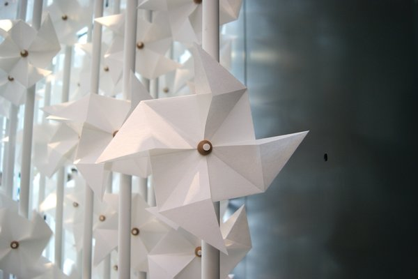 Continue through the museum's hallways, where you will be greeted by a hypnotic gateway made up of 5000 paper windmills. The installation is the work of Lebanese designer Najla El Zein, who named the piece 'The And Portal' - a playful airway that draws wind and light into the galleries beyond.