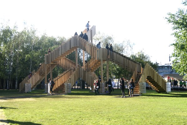 On the lawn of the Tate Modern museum, architects dRMM have installed a surreal staircase inspired by MC Escher. Overlooking the Thames, the staircase is constructed from a series of giant interlocking staircases made from American Tulipwood and sponsored by the American Hardwood Export Council.