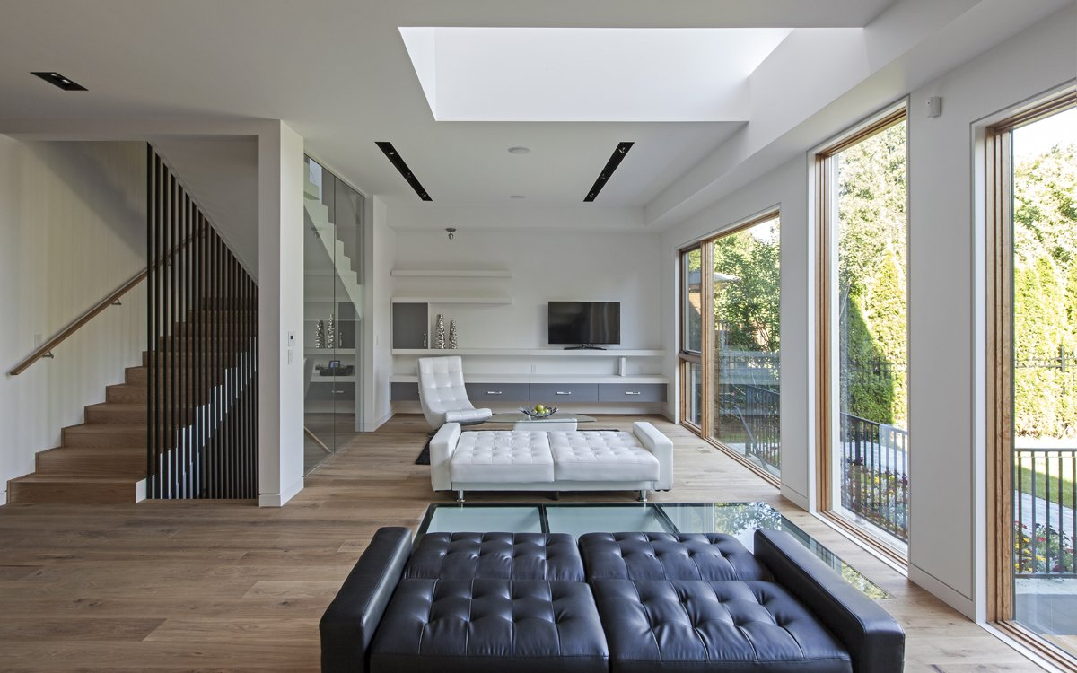 Living Room, Bench, and Medium Hardwood Floor The living area bathed with natural light both from the ceiling to floor glass walls and the void from the second floor allowing one to enjoy tremendous amount of daylight.  Photo 4 of 7 in Toronto's Tetris Inspired Home
