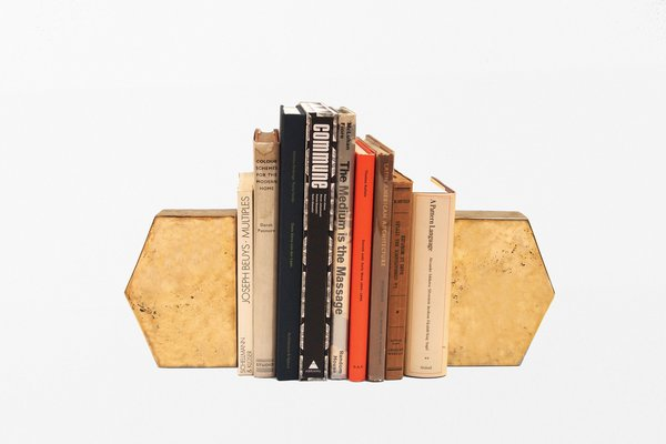 Brass Bookends by Commune, $900 from communedesign.com  To keep books neatly upright, you could do no better than these striking solid-brass items. (Yes, we listed Commune twice in this list because they're so darn good.)