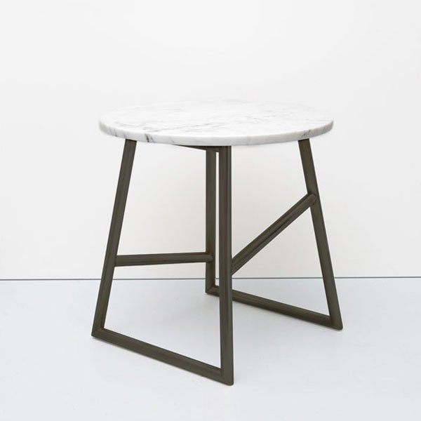 Algedi Marble Side Table by Iacoli & McAllister, $1,895 from store.dwell.com  Along with a light and a lounge chair, a side table completes the reading corner trifecta. We're partial to this marble-topped looker.