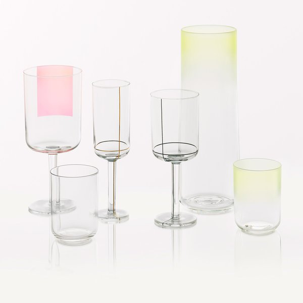 Hay Colour Glass The Colour Glass collection is a range of minimalist glassware by Scholten & Baijings. It includes high and low water glasses, a red wine glass, a white wine glass, a champagne glass and a carafe. The glasses and carafe come in in three different designs: with yellow or blue fading from the top, or a golden dot at the bottom of the vessels. The red wine glass comes with a pink square on one side, the white wine glass has black grid lines and the champagne glass features golden grid lines.  Find this item at the Dwell Store.