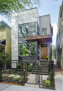 Chicago Net Positive Home (Kipnis Architecture + Planning)  Built for the owners of Uncommon Ground—a pair of cafés, one of which boasts an organic rooftop garden—this 2,900-square-foot home boasts an array of sustainable design features, from custom cabinetry made from insect-damaged wood to a treehouse-style study wrapped in reclaimed barn wood.