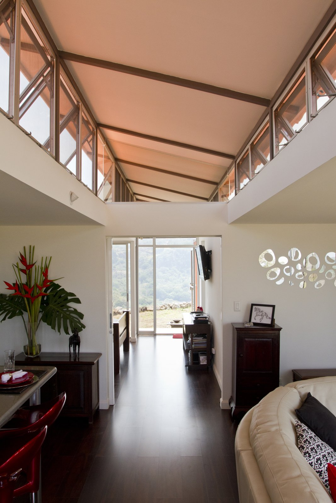 Wood floors were installed throughout the entire house. Walls are formed by simple plasterboard partitions, and enhanced with industrial-grade insulation.  A Budget-Friendly Shipping Container Home in Costa Rica  by Tiffany Jow
