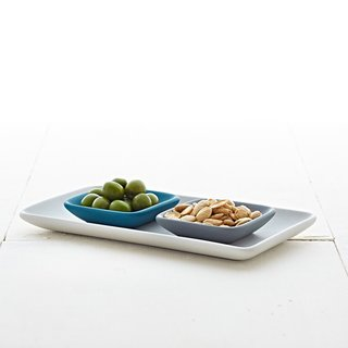 Three different serving plates in an array of winter blue, grey, and white make for easy holiday entertaining.
