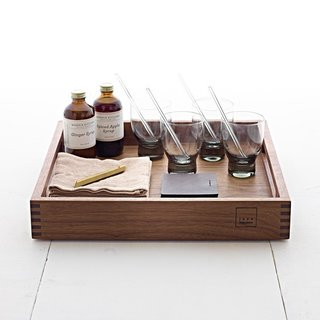 This Cocktail Set is the answer to easy and elegant holiday entertaining. Each piece is a beautiful object on its own; together, they make for a sophisticated display. Included is a Jose Reguiero square walnut tray, 4 Holmegaard water glasses, 4 glass Dharma straws and a cleaning brush, 4 Native Organics gauze napkins, 4 Sara Barner brown leather coasters, an Iacoli & McAllister hex bottle opener, Morris Kitchen Spiced Apple Syrup, and Morris Kitchen Ginger Syrup.