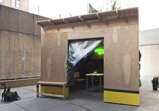 "The artist's iteration of the club for the Whitney Biennial this spring echoes the courtyard's geometry, but defies its austerity with a bohemian interior. The words ""break the ice"" glow in neon. A table with refreshments is flanked by Marcel Breuer Cesca chairs."