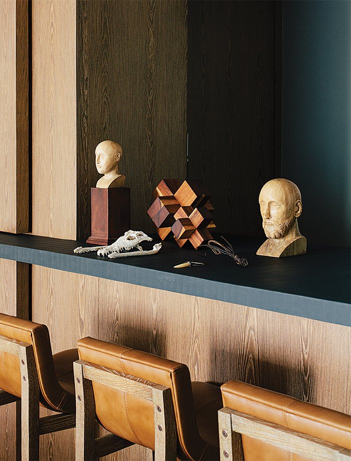 Dining Room and Stools In the dining room, antique wooden busts and a machiche cross designed by Farca are arranged on a resin countertop by Monica Calderon. The bar conceals a service area with an espresso machine.  Photo 14 of 15 in A Lush Retreat With a Sheltered Rooftop Pool in Mexico City