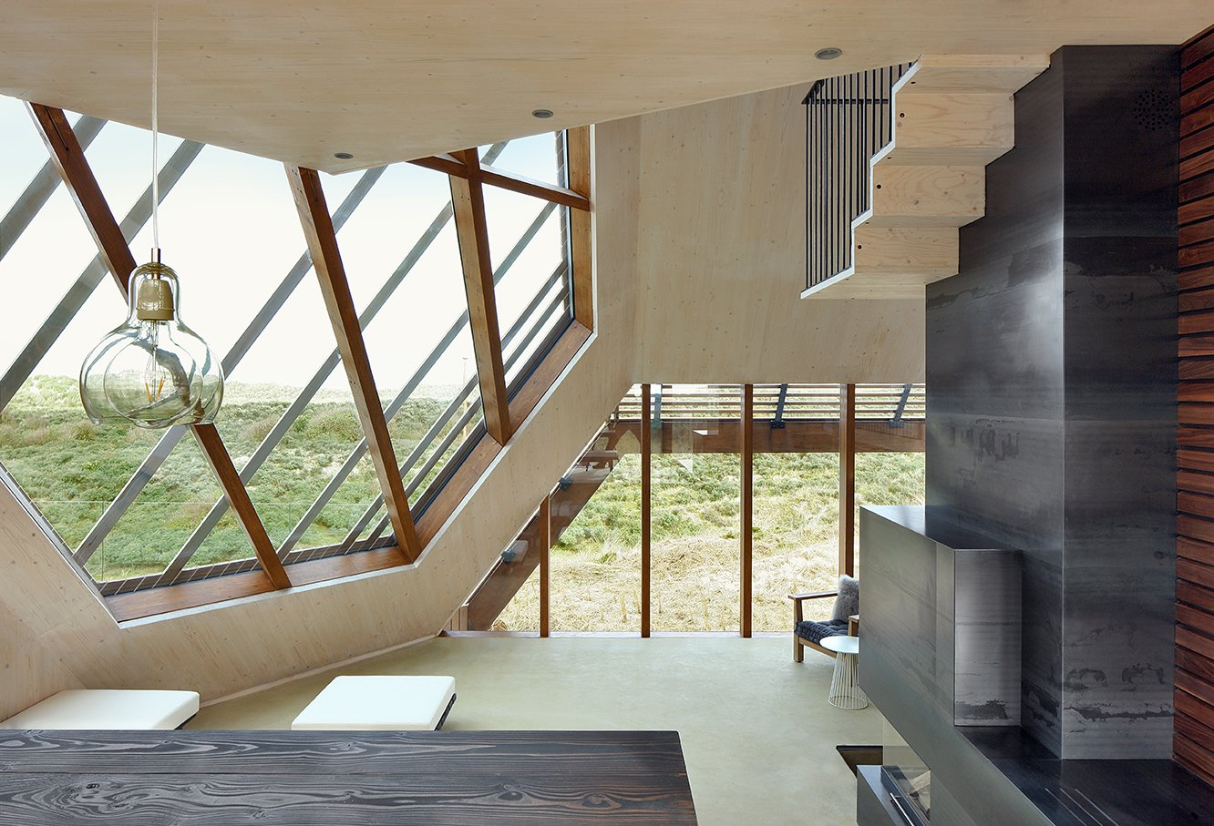 Each room in the interior was carefully curated to reflect the unique function of that space. The interior interacts intimately with the surrounding landscape, as different visual perspectives of the dunes are framed by the geometric facade.  Dune House by Sarah Akkoush