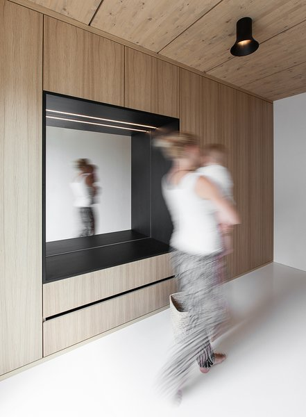 White polyurethane floors create the illusion of increased space, and add brightness and depth to the interior.  A Strikingly Minimal Home Built in Less Than Six Months by Tiffany Jow