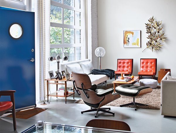 The couple supplemented the rawness of the open living area with funky secondhand finds from the 1960s, '70s, and '80s.