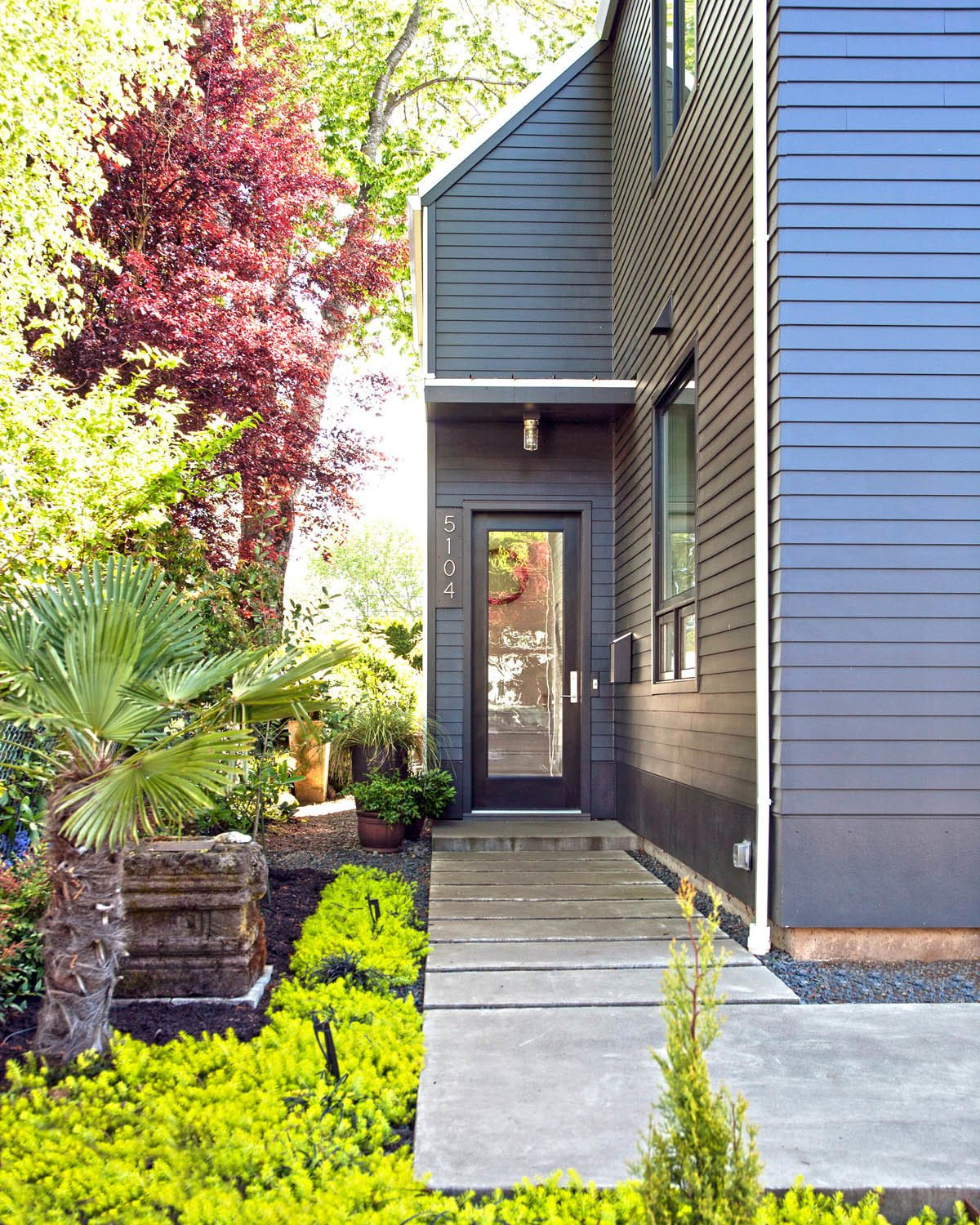 Outdoor, Front Yard, and Pavers Patio, Porch, Deck Inexpensive but sturdy James Hardie lap siding was used on the exterior.  Best Photos from Modern Gabled House in Portland