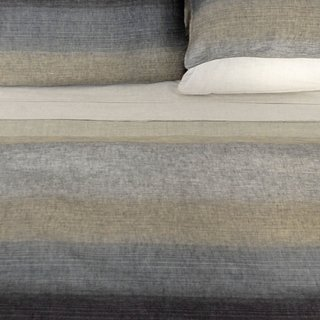 INES DUVET COVER  We love the earth-toned gradients in this duvet, shown here in the sand colorway. It's made from 100 percent linen, a material that wicks away moisture to keep you cool while you slumber.
