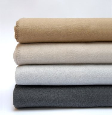 LLOYD  LLOYD in ash & charcoal are super cozy 100% cotton blankets and throws a with very soft hand and drape. Best of all they are Machine washable.