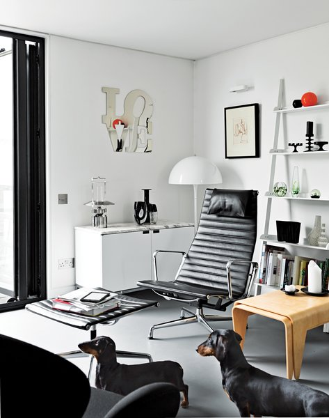 The room's opposite side holds the companion Breuer nesting tables and an Eames Aluminum Group chair and ottoman.