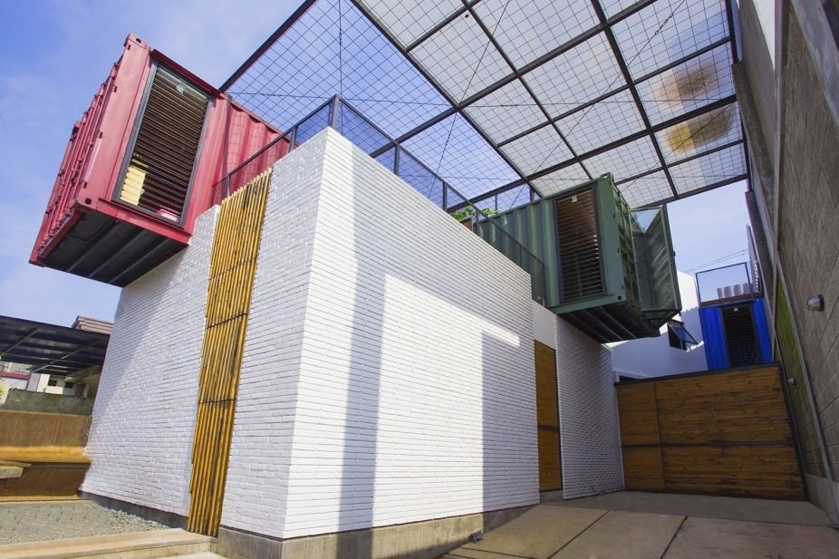 The 1,668-square-foot three-bedroom home is made of four colorful, crisscrossed containers equipped with a simple ventilation system that facilitates a constant breeze.  Photo 2 of 10 in How to Stay Cool by Living in a Shipping Container from In Indonesia, a Green-Roofed Container Home Stands Up to the Heat