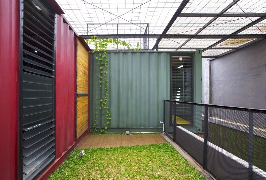 The top of the residence is wrapped in simple wire mesh to encourage plant propagation.  In Indonesia, a Green-Roofed Container Home Stands Up to the Heat by Tiffany Jow