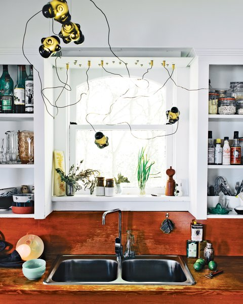 Above the sink in the kitchen, you can see one of Bocci's first 57 chandeliers. Photo by José Mandojana.
