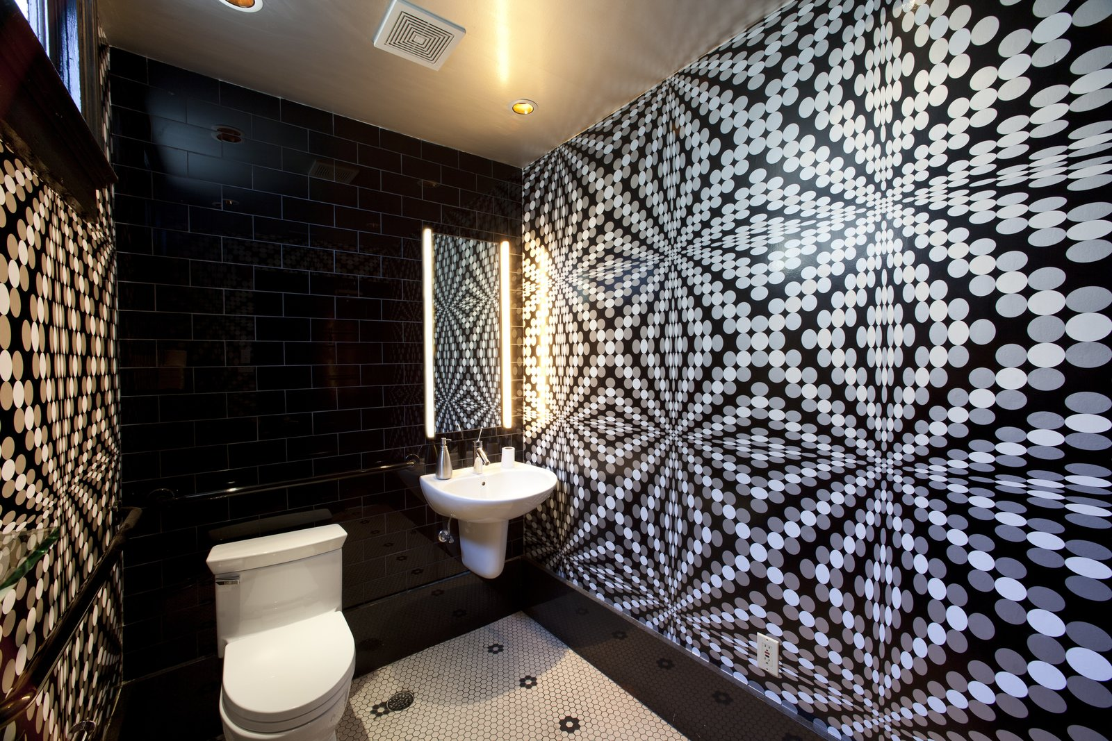 """Usage of the space to be wallpapered is also key,"" Sherman says. ""If you are installing in a bathroom, you certainly don't want to use anything water sensitive. And if you have kids or pets, you don't want anything that can't be cleaned easily. Once you have determined these aspects, you can swing any direction on color and pattern to suit your taste.""  Photo 19 of 42 in Wallpaper That Fixes Walls"