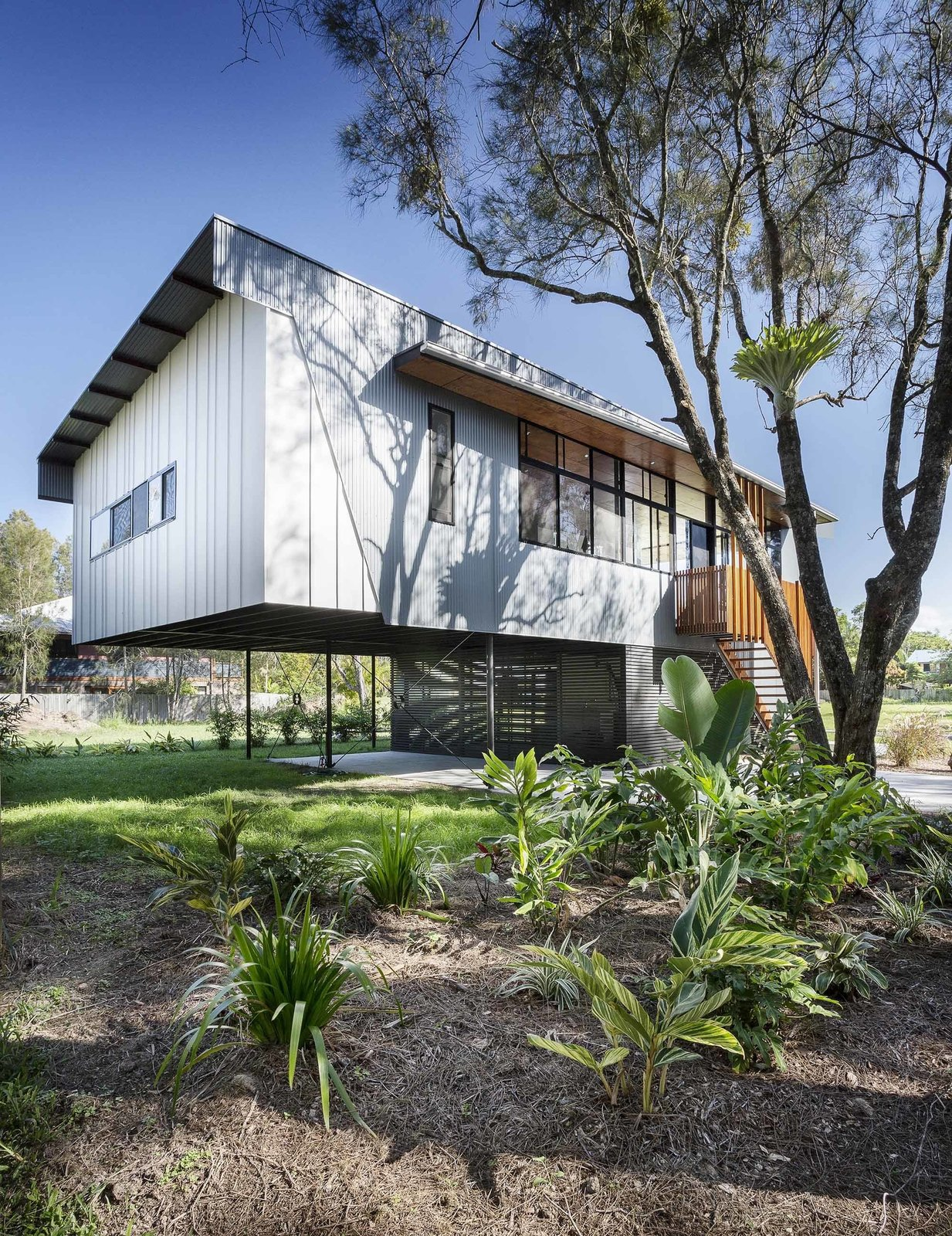 Exterior, House Building Type, and Metal Siding Material The largest portion of the living area is supported by cross-braced columns. Flanged steel beams create a strong, lightweight frame.  Northern Rivers Beach House by Tiffany Jow