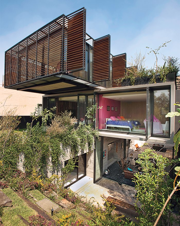 "Exterior and House Building Type ""The longer I work as an architect, the more I want to deepen my skills as a gardener,"" says Yuri Zagorin Alazraki, founder of the Mexico City firm ZD+A. In building his own house in Mexico City's Lomas de Chapultepec neighborhood, his commitment has produced results that appear miraculous. In fact, they grow out of a carefully choreographed series of bravura design moves.  Photo 2 of 6 in A Sublime Indoor/Outdoor Retreat in Mexico City"