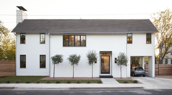 The exterior of the new, two-story home in East Austin, Texas was designed with a minimal palette, bronze windows, and steel details in order to blend into the existing cityscape.