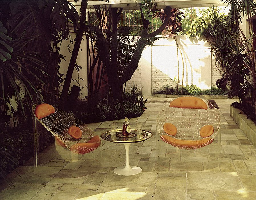 The MP-89 armchair (1970) was made with a diagonally cut Plexiglas cylinder, fishing net, and leather cushions.  Photo 3 of 7 in This Brazilian Modernist You Should Know About Designed Countless Classic Chairs