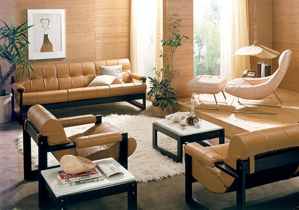"The MP-163 ""Earth Chair""and matching footstool in light beige, and the S1 collection of armchairs, sofas, and tables, designed in 1975.  Photo 7 of 7 in This Brazilian Modernist You Should Know About Designed Countless Classic Chairs"