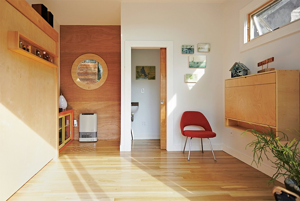 Living Room, Chair, and Light Hardwood Floor A found Eero Saarinen Executive chair was restored with help from a local auto body shop.  Photo 5 of 8 in A Family Builds a Tiny Backyard Studio on an Even Tinier Budget