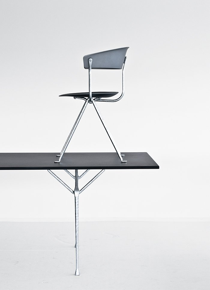 The Officina collection offers a range of material options, including steel, tempered glass, American walnut, Carrara marble, Ardesia slate, and leather. Shown here are the chair and table with galvanized, gray metallized frames.  Photo 2 of 3 in Product Designer Erwan Bouroullec on the Magic of Wrought Iron