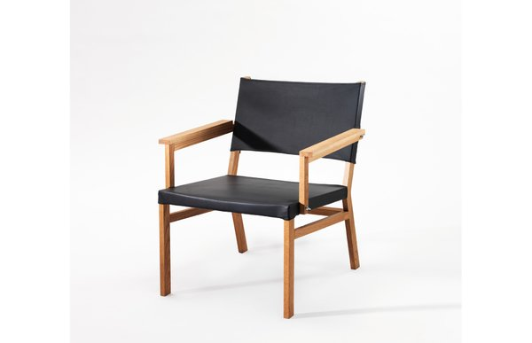 Frame Chair  The Frame easy chair has a distinct attitude with visible screws and wing nuts. The design is clean, raw and clear. Oak, leather and some small details in metal meets to create a comfortable easy chair.